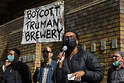 London, UK. 12th September, 2021. Dr Fatima Rajina, co-founder of Nijjor Manush, addresses local residents and supporters of the Save Brick Lane campaign outside the Truman Brewery following a funeral procession along Brick Lane organised in protest against the ongoing gentrification of Shoreditch. Campaigners are protesting in particular against plans to develop the Truman Brewery into a shopping centre and 5-storey office building. Tower Hamlets experienced more gentrification than any other London borough between 2010-2016.