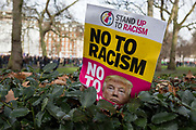 Detail of a placard on a hedge at the Stop Trump's Muslim ban demonstration on 4th February 2017 in London, United Kingdom. The protest was called on by Stop the War Coalition, Stand Up to Racism, Muslim Association of Britain, Muslim Engagement and Development, the Muslim Council of Britain, CND and Friends of Al-Aqsa. Thousands of demonstrators gathered to demonstrate against Trumps ban on Muslims, saying it must be opposed by all who are against racism and support basic human rights, and for Theresa May not to collude with him.