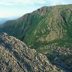 Lichens cover the metamorphic schist on Lion Head.  Boott Spur is in the distance across Tuckerman Ravine.  White Mountains National Forest. Mt. Washington, NH