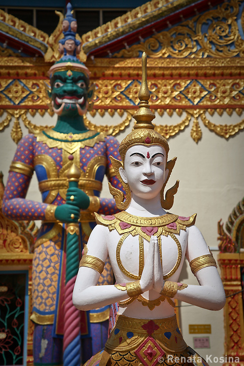 The gold in ornamental architecture of Wat Chayamangkalaram - a Thai temple of The Reclining Buddha glows in bright tropical sun. It is located in Georgetown on the island of Penang, Malaysia.