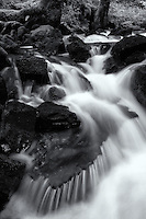 Water flows over rocks, creating ribbon-like skirt, Kodiak, Alaska