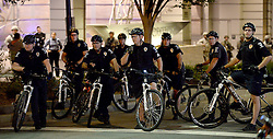 Charlotte-Mecklenburg bicycle police officers watch as protesters congregate near the intersection of Trade and College StreetsSaturday, September 24, 2016 in Charlotte, NC, USA. Protesters came together for the fifth straight night to protest following the fatal shooting of Keith Lamont Scott. Keith Lamont Scott was shot and killed by Charlotte-Mecklenburg Police Officer Brentley Vinson on Tuesday afternoon. Photo by Jeff Siner/Charlotte Observer/TNS/ABACAPRESS.COM
