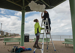 Across Portobello, Edinburgh artists are getting ready for this weekend's Art Walk Porty. A mixture of open studios, pop-up exhibition spaces, artists market and site-specitic art all over the Edinburgh suburb this weekend. The official launch takes place tonight (Thursday) but the event runs from Fri-Sun Sept 2nd-4th. 2016. Pictured: Juliana Capes installs her work at the Joppa Bandstand. <br /> <br /> <br /> © Jon Davey/ EEm