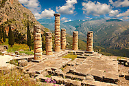 The ruins of the 4th century BC Temple of Apollo , a peripteral Doric building.  Delphi, archaeological site, Greece, .<br /> <br /> If you prefer to buy from our ALAMY PHOTO LIBRARY  Collection visit : https://www.alamy.com/portfolio/paul-williams-funkystock/delphi-site-greece.html  to refine search type subject etc into the LOWER SEARCH WITHIN GALLERY.<br /> <br /> Visit our ANCIENT GREEKS PHOTO COLLECTIONS for more photos to download or buy as wall art prints https://funkystock.photoshelter.com/gallery-collection/Ancient-Greeks-Art-Artefacts-Antiquities-Historic-Sites/C00004CnMmq_Xllw