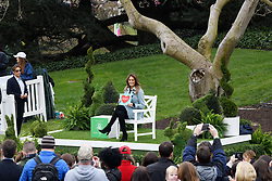 First Lady Melania Trump reads a book during the 140th Easter Egg Roll on the South Lawn of the White House in Washington, DC on Monday, April 2, 2018. Photo by Olivier Douliery/Abaca Press