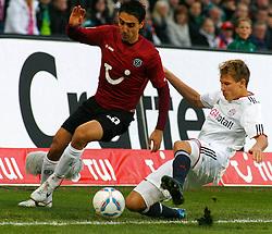 23.10.2011, AWD-Arena, Hannover, GER, 1.FBL, Hannover 96 vs FC Bayern Muenchen, im Bild  Mohamed Abdellaoue (Hannover #25) wird von  Holger Badstuber (Muenchen #28) gestoppt .// during the match from GER, 1.FBL, Hannover 96 vs FC Bayern Muenchen on 2011/10/23, AWD-Arena, Hannover, Germany. .EXPA Pictures © 2011, PhotoCredit: EXPA/ nph/  Schrader       ****** out of GER / CRO  / BEL ******