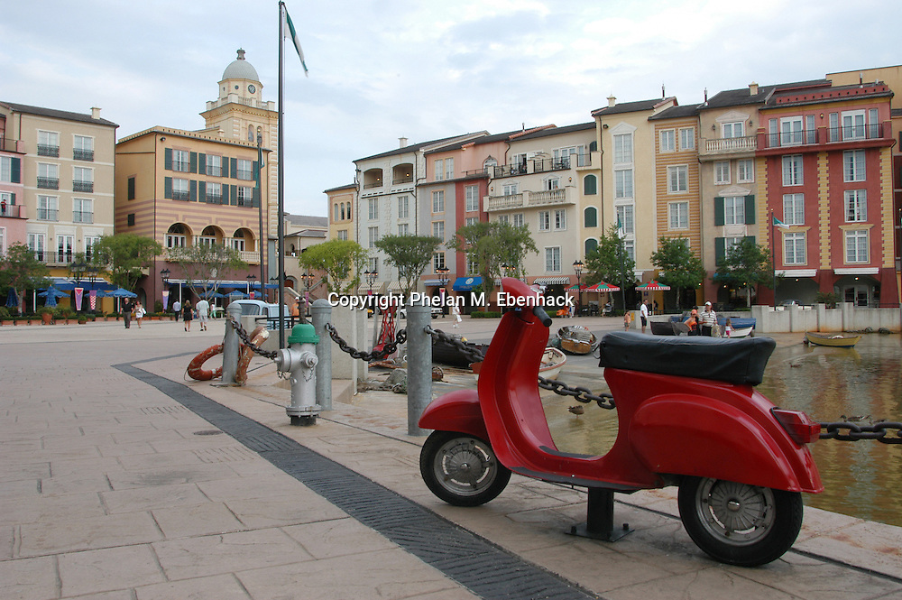 A Vespa motor scooter is parked along the waterfront at the Portofino Bay Hotel at the Universal Orlando Resort in Orlando, Florida.