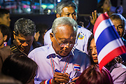 24 JANUARY 2014 - BANGKOK, THAILAND: SUTHEP THAUGSUBAN signs autographs backstage before speaking at the Shutdown Bangkok Pathum Wan site. Shutdown Bangkok has been going for 12 days with no resolution in sight. Suthep, the leader of the anti-government protests and the People's Democratic Reform Committee (PDRC), the umbrella organization of the protests,  is still demanding the caretaker government of Prime Minister Yingluck Shinawatra resign, the PM says she won't resign and intends to go ahead with the election.    PHOTO BY JACK KURTZ