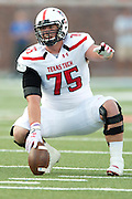 DALLAS, TX - AUGUST 30: Jared Kaster #75 of the Texas Tech Red Raiders reads the defense against the SMU Mustangs on August 30, 2013 at Gerald J. Ford Stadium in Dallas, Texas.  (Photo by Cooper Neill/Getty Images) *** Local Caption *** Jared Kaster
