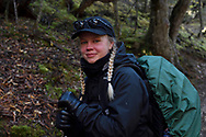 Liisa Widstrand, team participant, Wild Wonders of China,  hiking in the Baima Snow Mountain Nature reserve, Yunnan, China