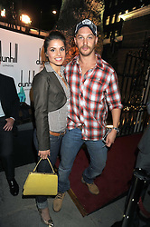 Actor TOM HARDY and actress CHARLOTTE RILEY at a party to celebrate the opening of the new home of Alfred Dunhill at Bourdon House, 2 Davies Street, London on 16th September 2008.