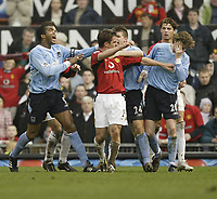 Photo. Aidan Ellis.<br /> Manchester United v Manchester City.<br /> FA Cup Fifth Round.<br /> 14/02/2004.<br /> City's Steve Mcmanaman reels away in pain after being headbutted by United's Gary Neville