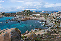 Bay and distant view of the cemetery for the victims of the SÈmillante shipwreck in 1855<br /> France: Corsica, Lavezzi Islands,