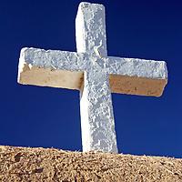 USA, New Mexico, Taos. A wooden cross of the San Francisco de Asis adobe church, a National Historic landmark in Taos, New Mexico.