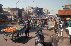 Chandni Chowk; a main shopping street in Delhi; India; with fruit stall in foreground,