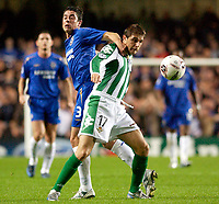 Photo: Daniel Hambury.<br />Chelsea v Real Betis. UEFA Champions League.<br />19/10/2005.<br />Chelsea's Asier Del Horno and Betis' Joaquin battle for the ball.