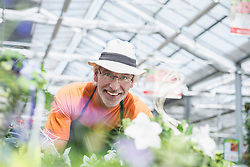 Portrait of a Male gardener working in greenhouse, Augsburg, Bavaria, Germany