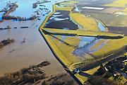 Nederland, Gelderland, De Voorster Klei , 20-01-2011; Gemaal Middelbeek, aan de grens van de Voorsterklei. Links van de bandijk de door het hoge water ondergelopen uiterwaard de Rammelwaard. De dijk links van het gemaal zal in het kader van Ruimte voor de Rivier verlaagd worden en er wordt een nieuwe dijk aangelegd (meer landinwaarts). Door de dijkverlegging zal er bij toekomstig hoogwater een waterstanddaling optreden..Pumping-station Middelbeek  (bottom) on the bank of the river IJssel near Zutphen, high waters..In the area left of pumping station the dike will be partially excavated, creating more 'room for the river', decreasing water levels in case of future high waters (flood). A new dike will  be build further away from the river..luchtfoto (toeslag), aerial photo (additional fee required).copyright foto/photo Siebe Swart