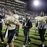 UCF Knights quarterback Blake Bortles (5) and UCF Knights offensive linesman Torrian Wilson (72) walk off the field after defeating the South Florida Bulls by a score on 23-20 at Bright House Networks Stadium on Friday, November 29, 2013 in Orlando, Florida. (AP Photo/Alex Menendez)
