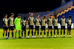 Colchester United players during a minute silence - Mandatory by-line: Ryan Crockett/JMP - 20/11/2020 - FOOTBALL - One Call Stadium - Mansfield, England - Mansfield Town v Colchester United - Sky Bet League Two