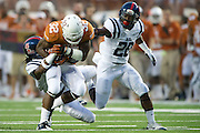 AUSTIN, TX - SEPTEMBER 14: Johnathan Gray #32 of the Texas Longhorns is brought down by Trae Elston #7 and Mike Hilton #28 of the Mississippi Rebels on September 14, 2013 at Darrell K Royal-Texas Memorial Stadium in Austin, Texas.  (Photo by Cooper Neill/Getty Images) *** Local Caption *** Johnathan Gray; Trae Elston; Mike Hilton