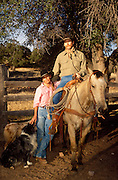 Kate Ladson and Mark Duncan in corral, Vera Earl Ranch, near Sonoita, Arizona.©1991 Edward McCain. All rights reserved. McCain Photography, McCain Creative, Inc.