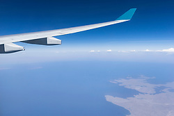 Cropped image of airplane flying above oman and red sea Iran, Oman