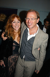 CHARLOTTE TILBURY and DAVID COLLINS at a party to celebrate the publication of 'The year of Eating Dangerously' by Tom Parker Bowles held at Kensington Place, 201 Kensington Church Street, London on 12th october 2006.<br /><br />NON EXCLUSIVE - WORLD RIGHTS