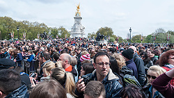 © Licensed to London News Pictures. 02/05/2015. London, UK. As huge crowds look on, in keeping with tradition, the royal birth announcement of the Duke and Duchess of Cambridge's second child, a daughter, born at 8.34am, today, 2 May 2015, is posted on an easel outside Buckingham Palace.  The document is signed by the the delivery team at St Mary's Hospital in Paddington - led by Alan Farthing, the royal surgeon-gynaecologist . Photo credit : Stephen Chung/LNP