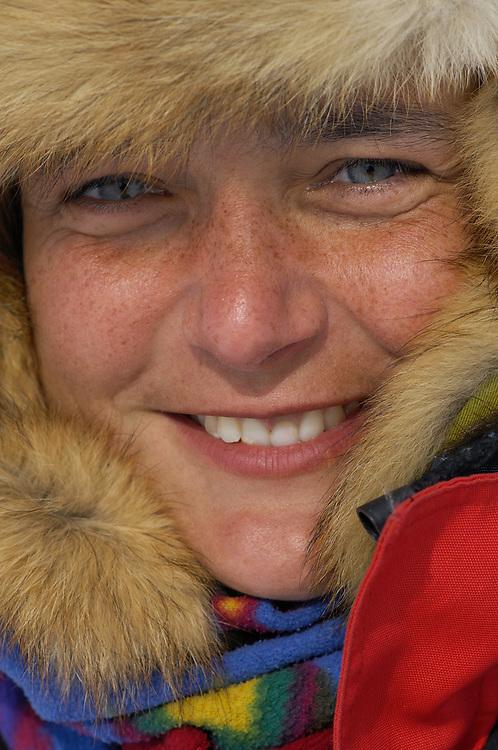 Ecotourist Laure Couvret from the Netherlands, Reindeer (Rangifer tarandus), Reindeer sledding safari ecotourism, Sami tour outfitter Per-Nils Päiviö, Nature's Best, Övre Soppero, Lapland, Norrbotten, Sweden.