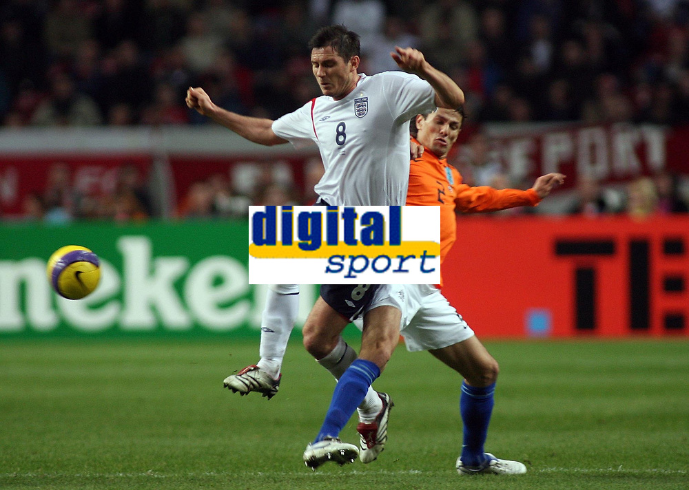 Photo: Paul Thomas.<br /> Holland v England. International Friendly. 15/11/2006.<br /> <br /> Frank Lampard (L) of England is tackled by Chelsea team mate Khalid Boulahrouz.