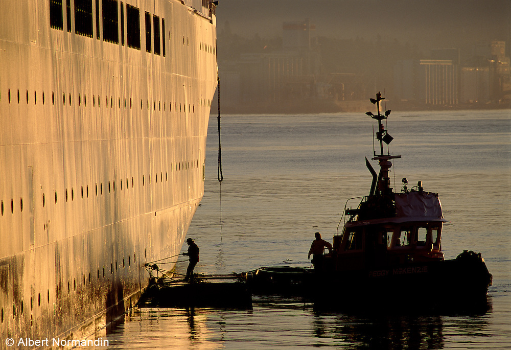 Tug boat and ship in sunrise light