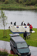 Funeral home members move the body Yaya. Irun (Basque Country). May 22, 2021.  Yaya, a 28 years old migrant from Côte d'Ivoire tried to cross the Spanish-French border swimming across the Bidasoa river.  As police controls on the two bridges crossing the border from Irun increased, migrants started using alternative routes  and some tries to cross the border swimming in this area.  (Gari Garaialde / Bostok Photo)