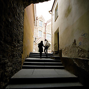 Couple walking in ons of Talliin's Old Town alleys