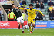 Freddie Ladapo (19) of Plymouth Argyle battles for possession with Tom Soares (19) of AFC Wimbledon during the EFL Sky Bet League 1 match between Plymouth Argyle and AFC Wimbledon at Home Park, Plymouth, England on 6 October 2018.