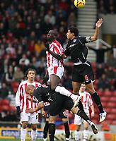 Photo:Mark Stephenson, Stoke City v West Bromwich Albion.<br />Coca Cola Championshipe,25-11-2006.<br />Stokes Danny Higginbotham (L) and wba Curtis Davis.