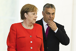 July 5, 2018 - Berlin, Germany - German Chancellor Angela Merkel and Hungarian Prime Minister Viktor Orban arrive to a press conference at the Chancellery in Berlin, Germany on July 5, 2018. (Credit Image: © Emmanuele Contini/NurPhoto via ZUMA Press)