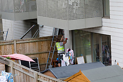 © Licensed to London News Pictures. 04/06/2017. LONDON, UK.  Scaffolding is erected around a ground floor flat at a block of flats in Kings Road, Barking where police arrested several people today in connection with the London Bridge terror attack. Photo credit: Vickie Flores/LNP