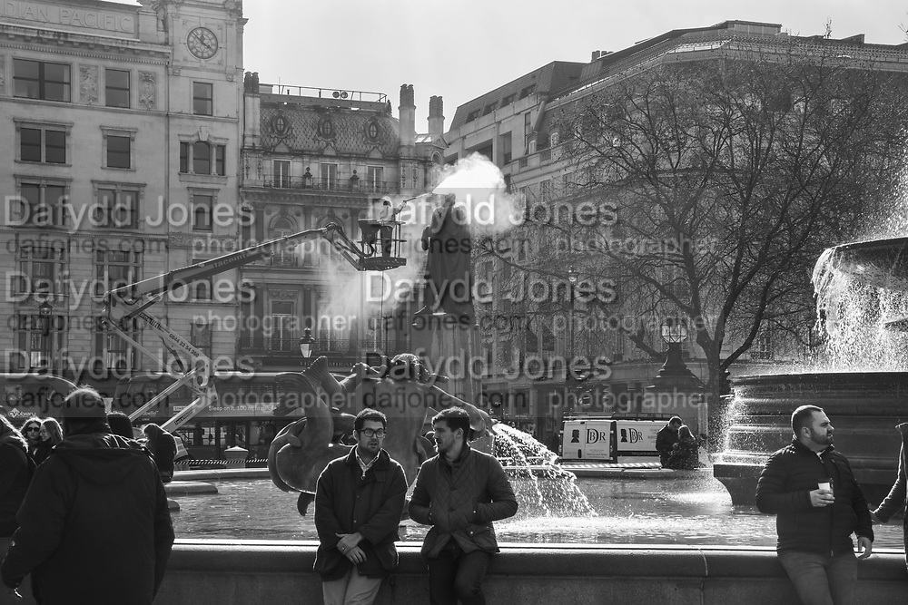 Winston Bogle of DBR Conservation maintenance cleaning statue of General Charles James Napier in Trafalgar Sq. London. . 7 March 2018
