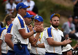 Team Europe's Tyrrell Hatton (right) looks dejected as he applauds Team USA players as they lift the Ryder Cup trophy at the end of day three of the 43rd Ryder Cup at Whistling Straits, Wisconsin. Picture date: Sunday September 26, 2021.