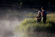 Father and daughter fishing.