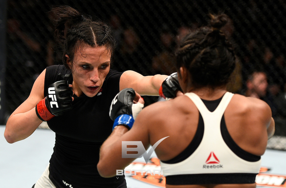 TORONTO, CANADA - DECEMBER 10:  (L-R) Valerie Letourneau of Canada punches Viviane Pereira of Brazil in their women's strawweight bout during the UFC 206 event inside the Air Canada Centre on December 10, 2016 in Toronto, Ontario, Canada. (Photo by Jeff Bottari/Zuffa LLC/Zuffa LLC via Getty Images)