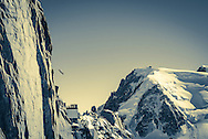 Nathan Jones a BASE jumper and wingsuit pilot leaves the Aiguille du Midi above Chamonix, in a wingsuit.