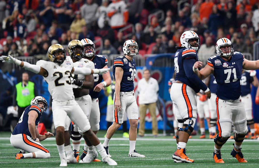 Auburn Tigers place kicker Daniel Carlson (38) watches as his attempted field goal falls short during the Chick-fil-A Peach Bowl NCAA college football game against the University of Central Florida January 1, 2018, in Atlanta. (David Tulis via Abell Images for Chick-fil-A Peach Bowl)
