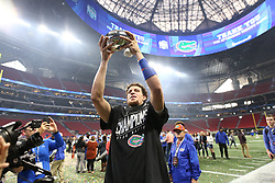 Florida Gators quarterback Feleipe Franks (13) celebrates after winning the Chick-fil-A Bowl Game at  the Mercedes-Benz Stadium, Saturday, December 29, 2018, in Atlanta. ( AJ Reynolds via Abell Images for Chick-fil-A Kickoff)