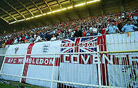 Photograph: Scott Heavey.<br />England v Macadonia at the City Stadium in Skopje, Macadonia. 05/09/2003.<br />The English fans make their presence known with huge St.Georges cross flags.