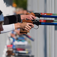 Competitors shoot as Egypt's Aya Medany (L) prepares her weapon during the Modern Pentathlon Women's World Cup held in Budapest, Hungary on May 07, 2011. ATTILA VOLGYI