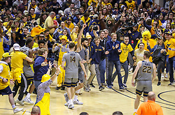 Mar 7, 2020; Morgantown, West Virginia, USA; West Virginia Mountaineers players and fans celebrate after defeating the Baylor Bears at WVU Coliseum. Mandatory Credit: Ben Queen-USA TODAY Sports