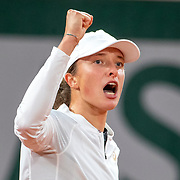 PARIS, FRANCE October 04.  Iga Swiatek of Poland in celebrates a break of serve against Simona Halep of Romania in the fourth round of the singles competition on Court Philippe-Chatrier during the French Open Tennis Tournament at Roland Garros on October 4th 2020 in Paris, France. (Photo by Tim Clayton/Corbis via Getty Images)