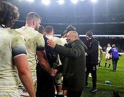 England coach Eddie Jones (right) congratulates his players after the final whistle during the NatWest 6 Nations match at Twickenham Stadium, London.